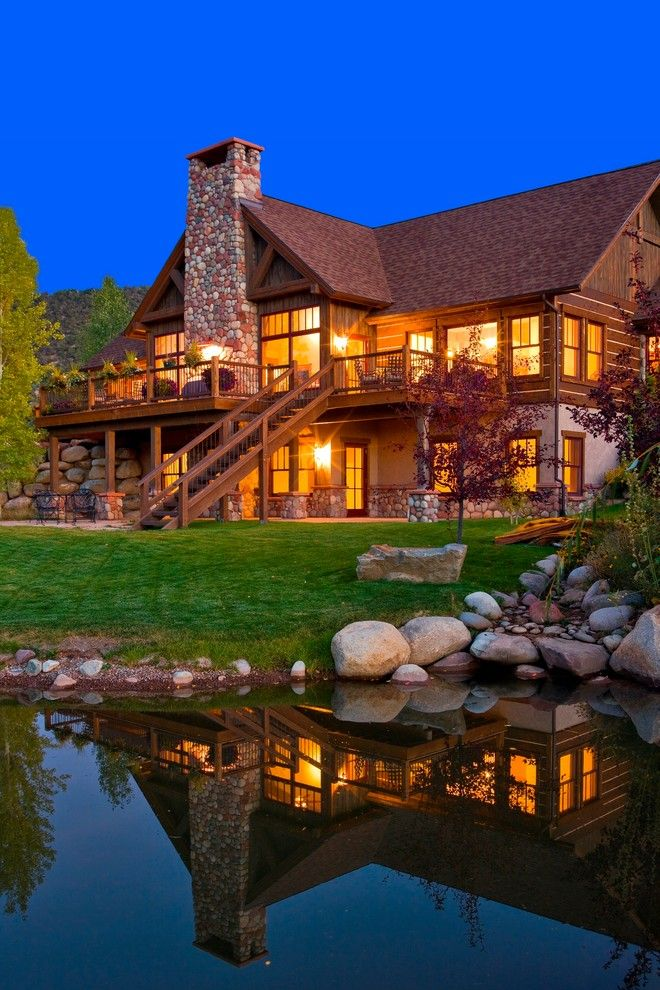 Walkout Basement for a Rustic Exterior with a Mountain Home and Colorado Mountain Home by Environmental Dynamics, Inc.