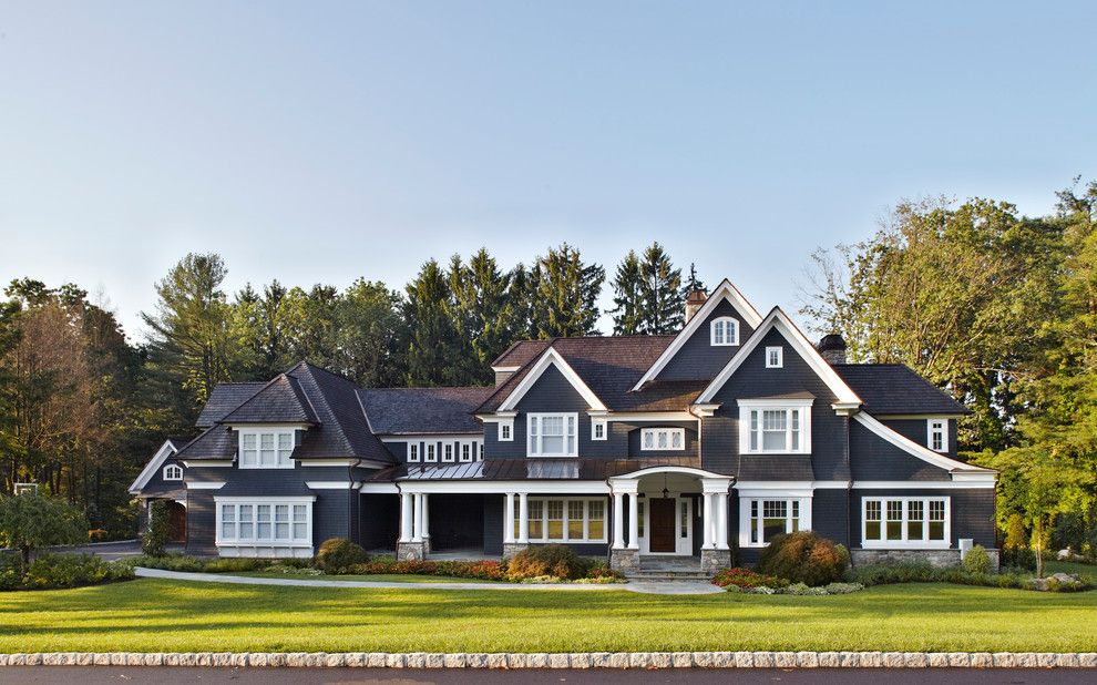 Walkout Basement House Plans for a Traditional Exterior with a White Trim and a New Home in the New York Suburbs by Degraw & Dehaan Architects