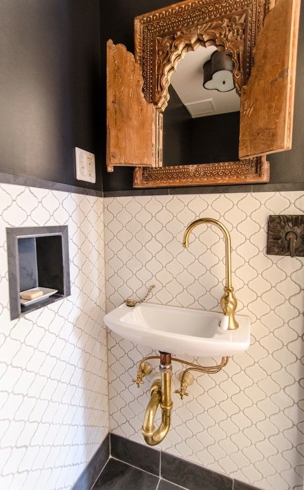 Wallington Plumbing Supply for a Mediterranean Powder Room with a Antique Carved Wooden Mirror Frame and Prospect Heights Brownstone by Indigo & Ochre Design