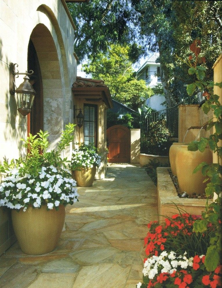 Water Spigot for a Mediterranean Landscape with a Wood Gate and Mediterranean Landscape by Environmentaldesignslandscape.com