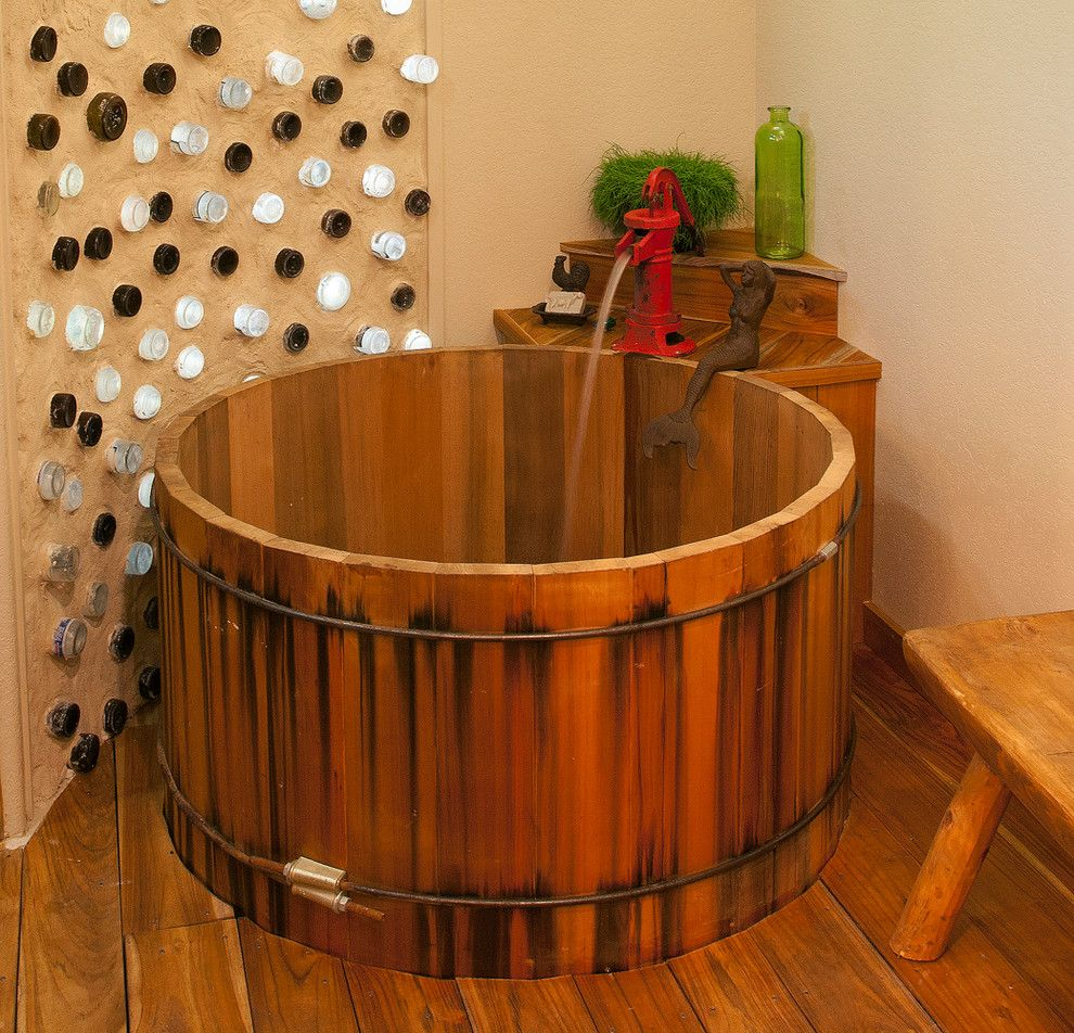 Water Spigot for a Rustic Bathroom with a Reclaimed and Round Cedar Soaking Tub by Wright Built