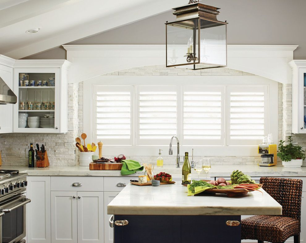 Waterfall Countertop for a Contemporary Kitchen with a Kitchen Island Lighting and White Plantation Shutters for the Kitchen by Budget Blinds