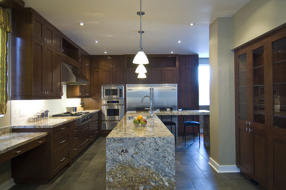 Waterfall Countertop for a Contemporary Kitchen with a Tile Backsplash and a Chef's Dream by Biglarkinyan Design Planning Inc.