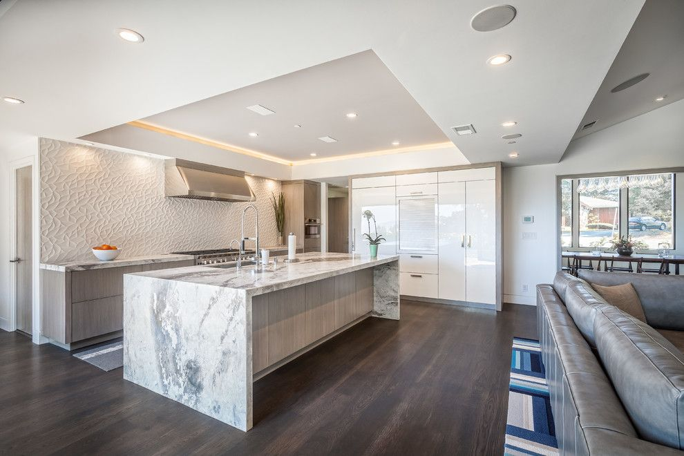 Waterfall Countertop for a Contemporary Kitchen with a Tray Ceiling and Hillsborough 2 by A.v. Builders Inc.