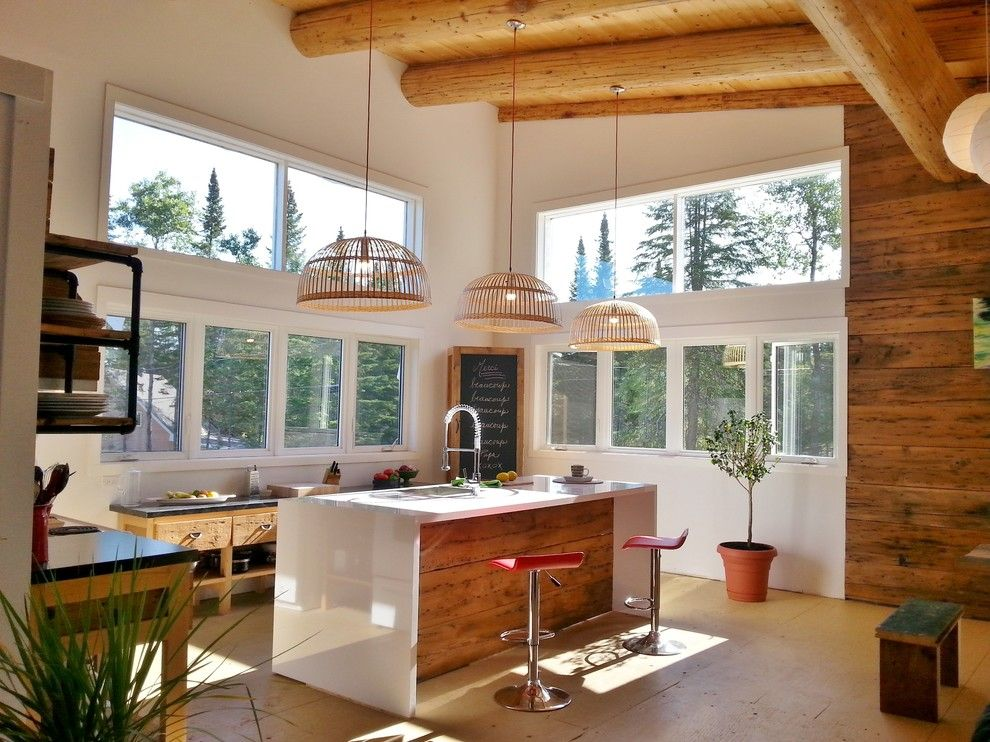 Waterfall Countertop for a Farmhouse Kitchen with a Wood Ceiling and Loft Lumineux by Oumf Design