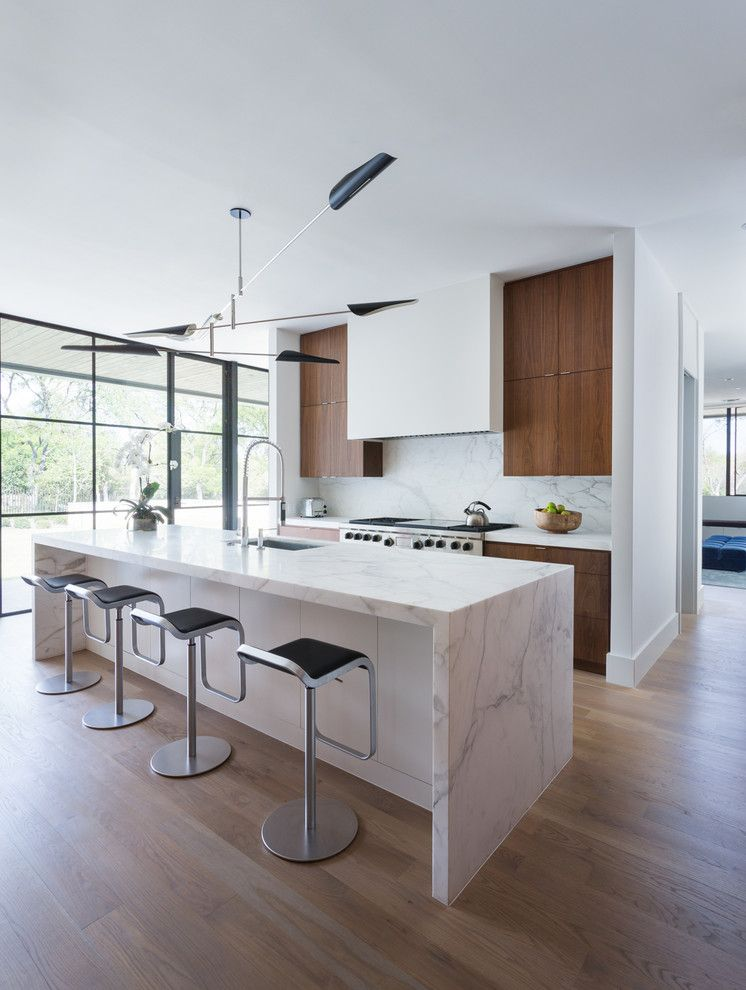 Waterfall Countertop for a  Kitchen with a Calcutta Gold Marble and Simply Modern by Tim Cuppett Architects