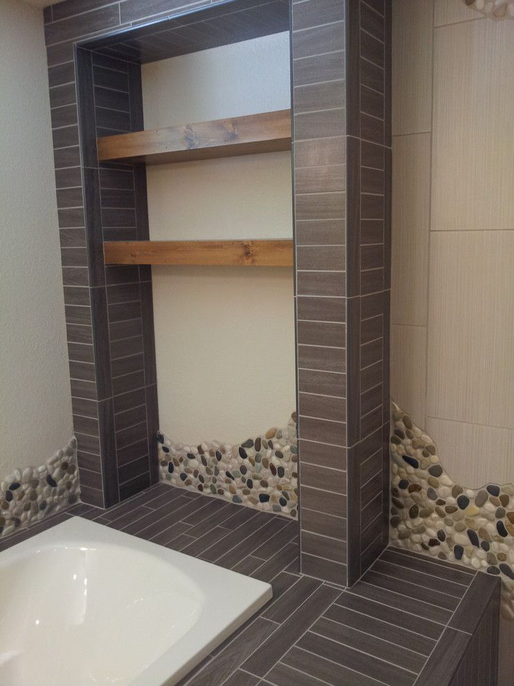 Wausau Tile for a Rustic Bathroom with a Bath Tub and Hazelhurst Renovation by Floorology