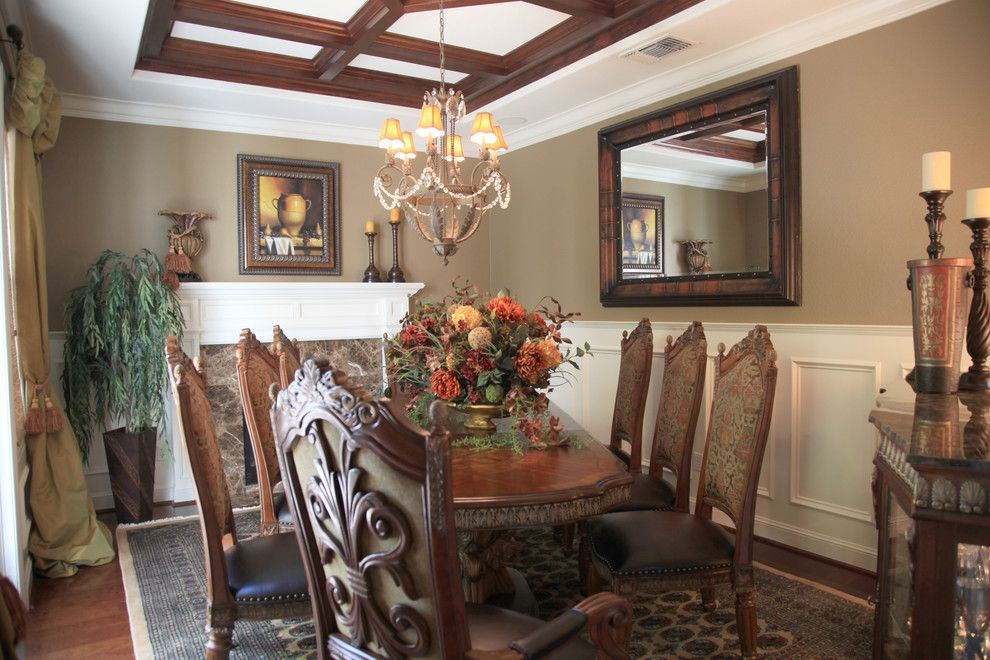 Waynes Coating for a Mediterranean Dining Room with a Mantel and Dining Room by J. Hettinger Interiors