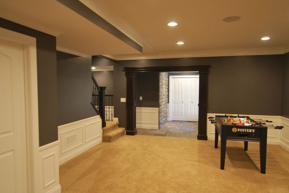 Waynes Coating for a Traditional Basement with a Traditional and Patrick Basement by Plan 2 Finish, Inc.