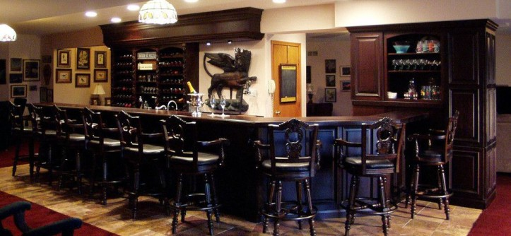 Wayside Furniture for a Traditional Basement with a Old World and English Pub Lower Level Bar by Kitchen Design Group