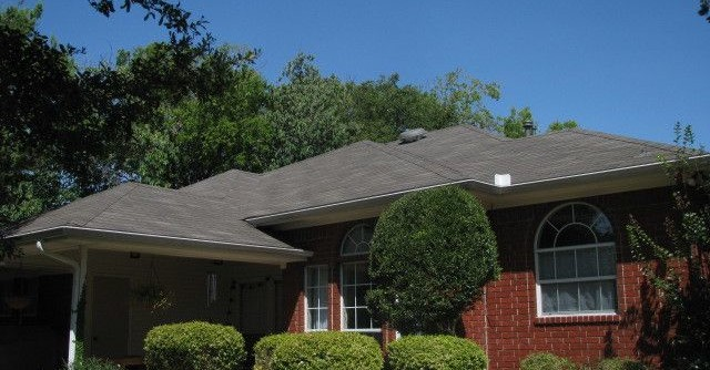 Weathered Wood Shingles for a Traditional Exterior with a Dallas Roofing Company and Weathered-Wood Shingled Roof by Rhino Construction