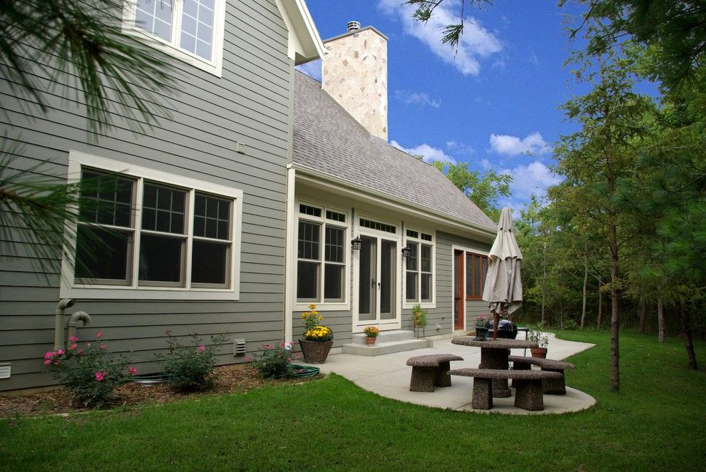 Weathered Wood Shingles for a Traditional Patio with a Patio Seating and Gravel Residence by Highland Builders Llc