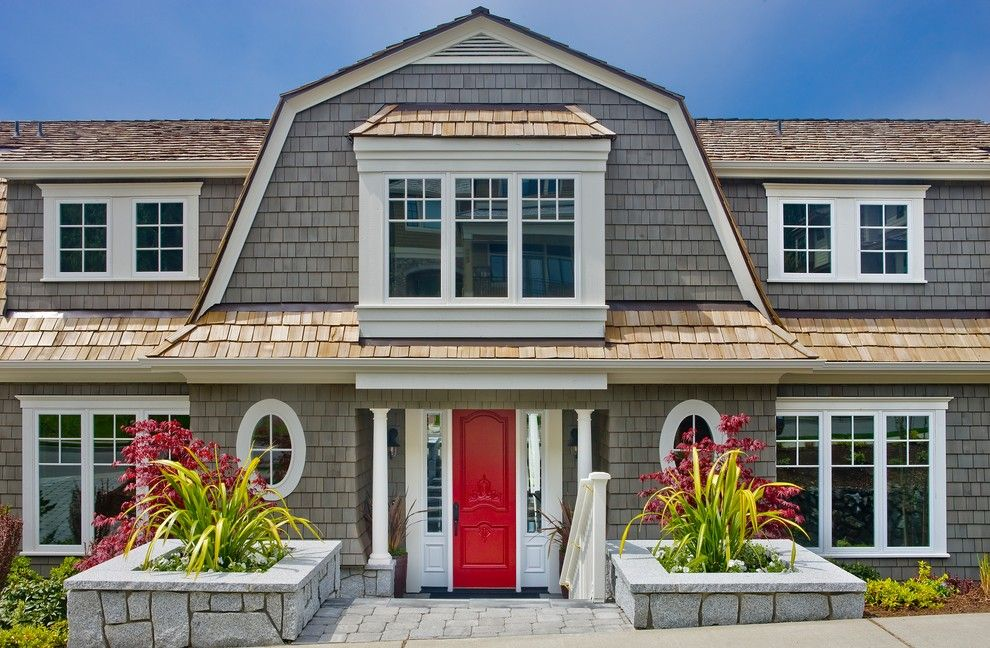 Weathered Wood Shingles for a Victorian Exterior with a Red Door and Glass by Gelotte Hommas Architecture