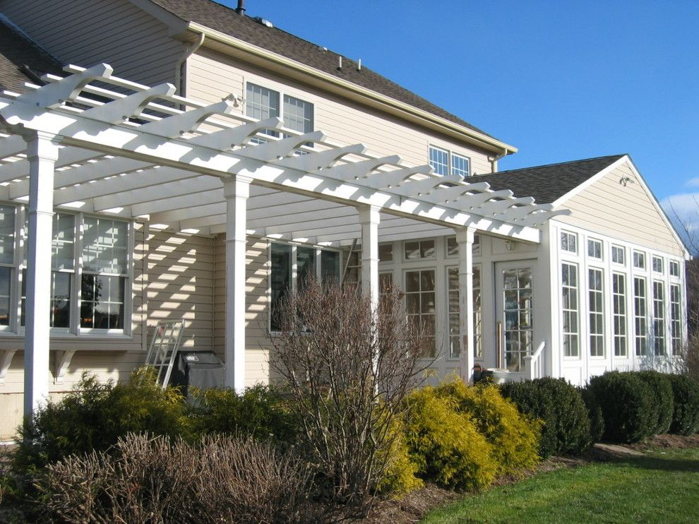 Weathershield Windows for a Traditional Exterior with a Awning Windows and Sunroom with Adjoining Pergola by O'connor Contracting Llc