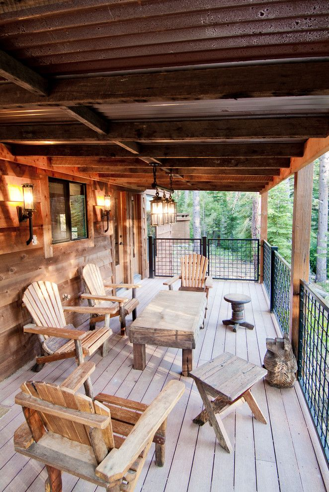 Wells Fargo Reo for a Rustic Deck with a Side Table and Beaver Pond by High Camp Home