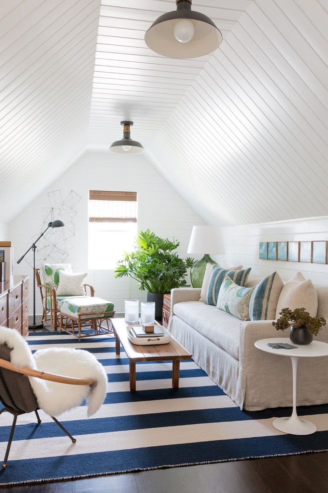 Wesley Hall Furniture for a Beach Style Family Room with a Floral Fabric and Attic Den by Matthew Caughy Interiors