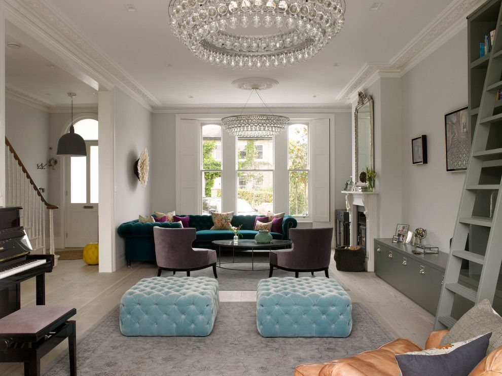Wesley Hall Furniture for a Victorian Living Room with a Mantel Mirror and Wimbledon House by Stephen Fletcher Architects