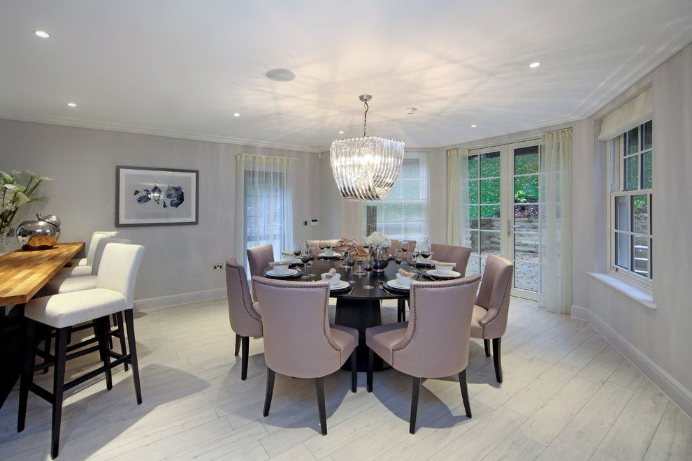 Westfield Lighting for a Transitional Dining Room with a Black Round Dining Table and Westfield House by Micasa