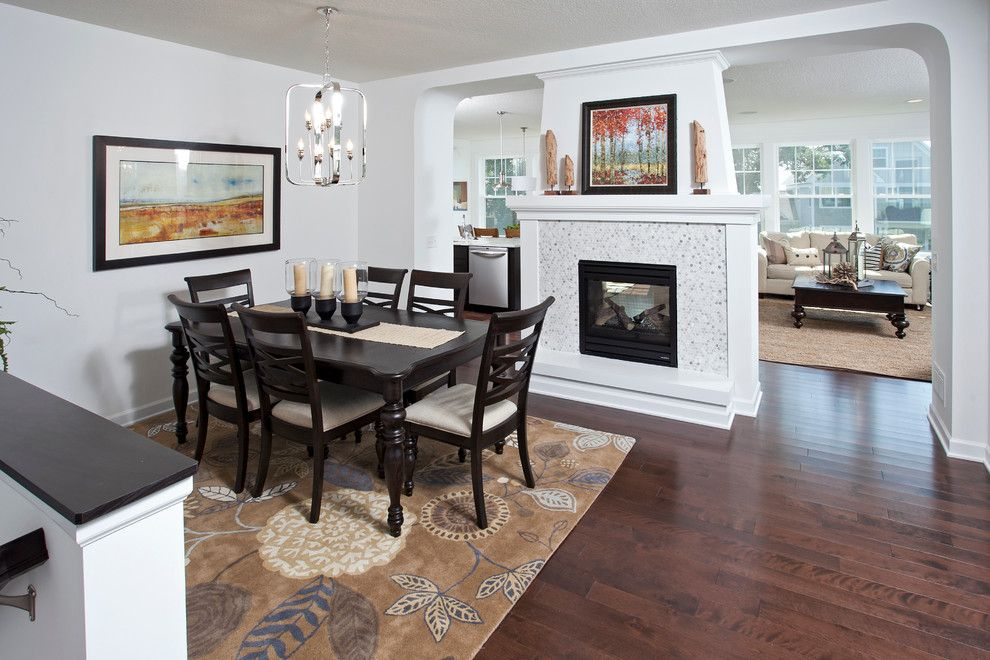 Westfield Lighting for a Transitional Dining Room with a Center Fireplace and the Westfield   Fall 2013 Parade of Homes Model by Homes by Tradition