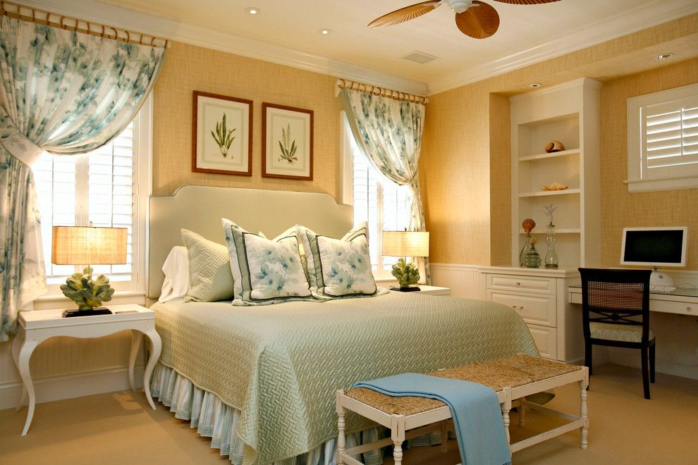 What is a Coverlet for a Tropical Bedroom with a Ceiling Fan and One of a Kind Custom Home at Grey Oaks by Romanza Interior Design