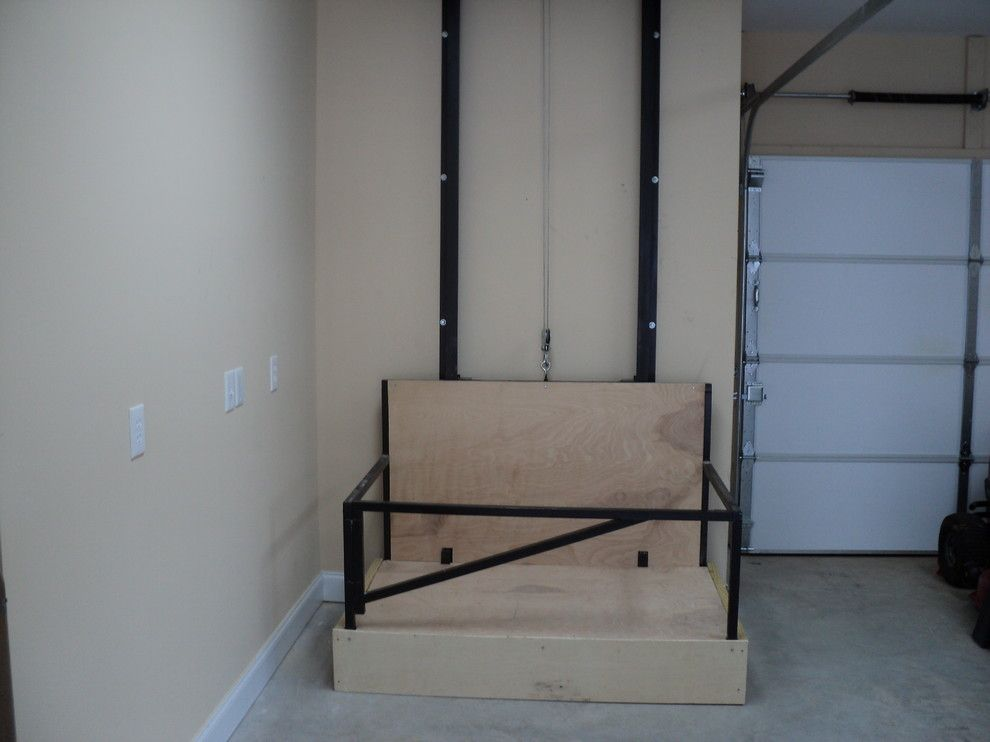 What is a Dumbwaiter for a  Spaces with a Custom Garage and Dumb Waiter by Don Thomas Construction