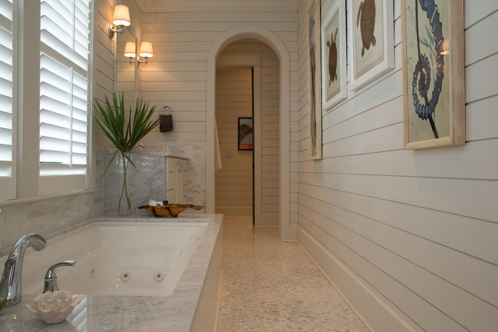 What is Shiplap for a Beach Style Bathroom with a Marble Tub Surround and Rice Watersound Residence 1 by Eric Marcus Studio
