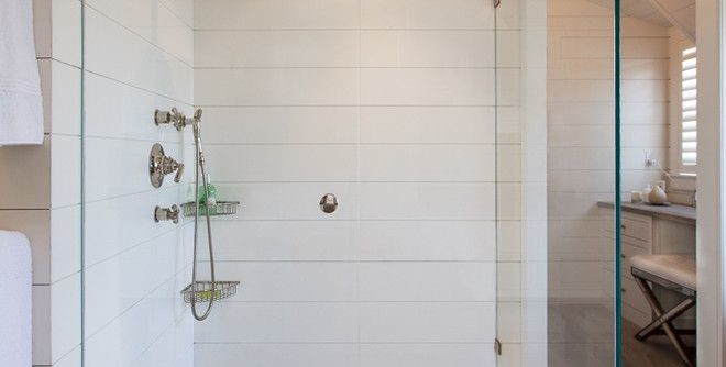 What is Shiplap for a Beach Style Bathroom with a Mosaic Floor Tile and Cliff Road Area - Nantucket by Jonathan Raith Inc.
