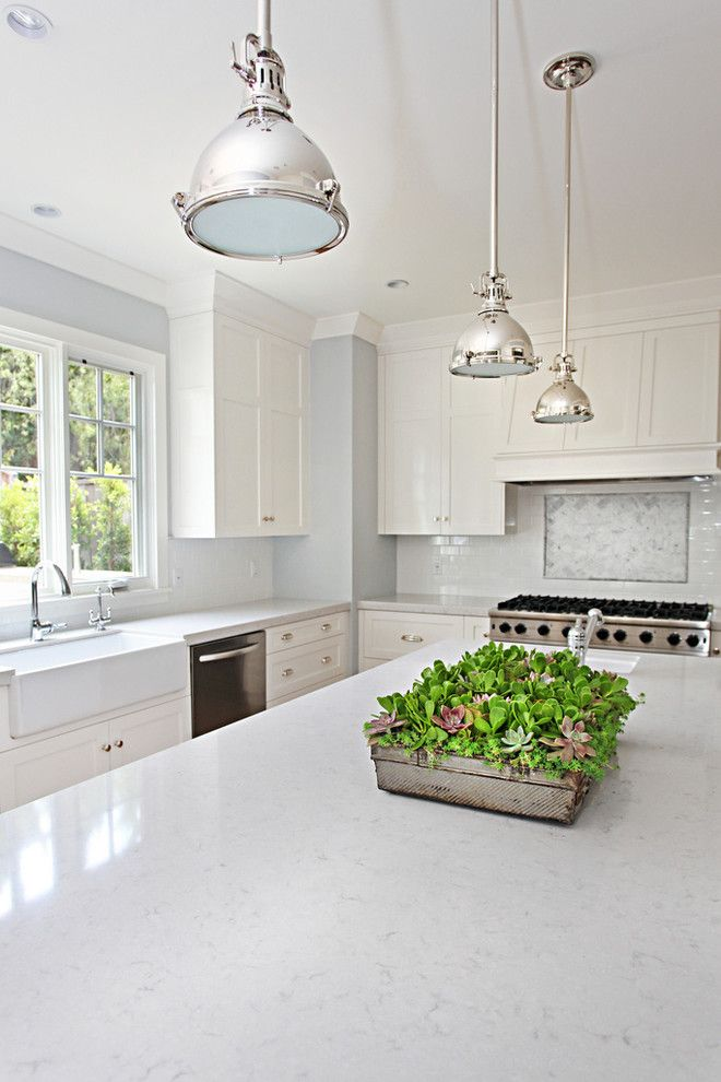 What is Silestone for a Transitional Kitchen with a Chrome Pendant Lights and Claridge by Brooke Wagner Design