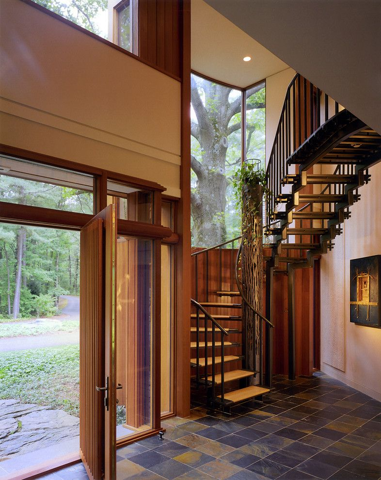 Wheeler Metals for a Contemporary Staircase with a Slatted Door and Modern