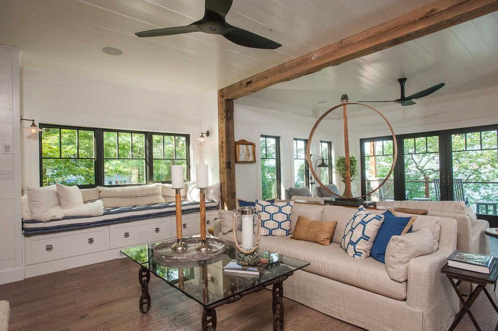 Wheeler Metals for a Rustic Living Room with a Exposed Beams and Lake George Retreat by Phinney Design Group