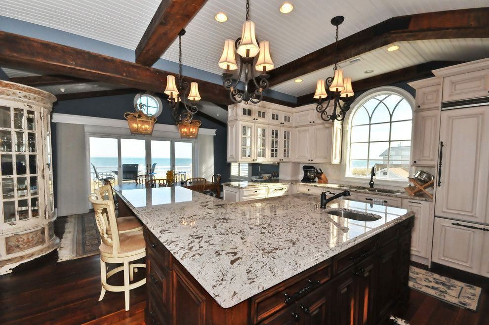 White Galaxy Granite for a Mediterranean Kitchen with a Breakfast Bar and Kitchen by Echelon Custom Homes