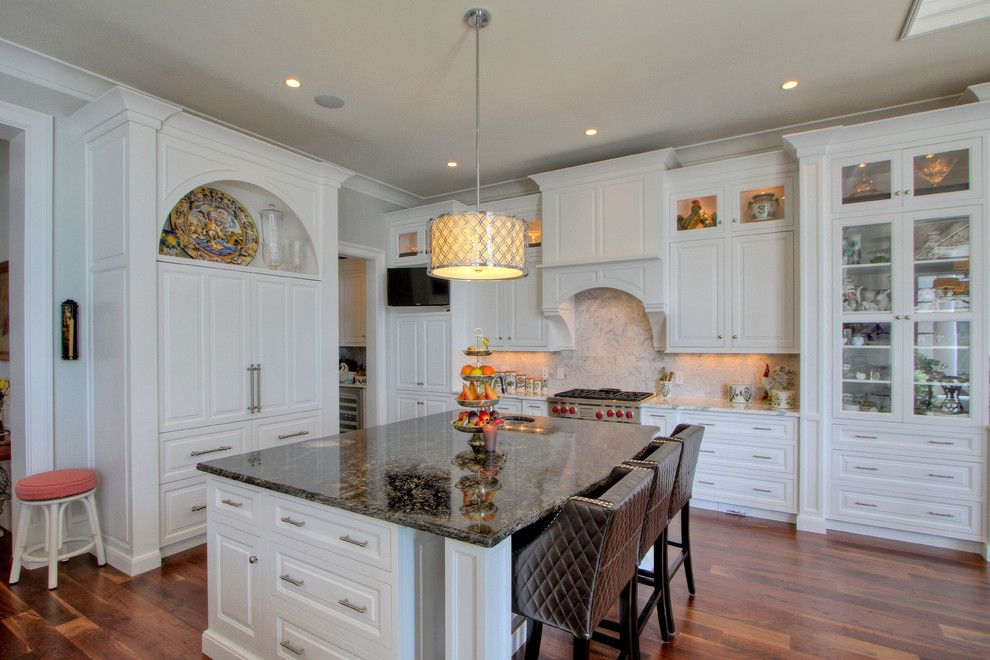 White Galaxy Granite for a Traditional Kitchen with a Carerra Marble Countertops and Classic White Kitchen by Palmetto Cabinet Studio