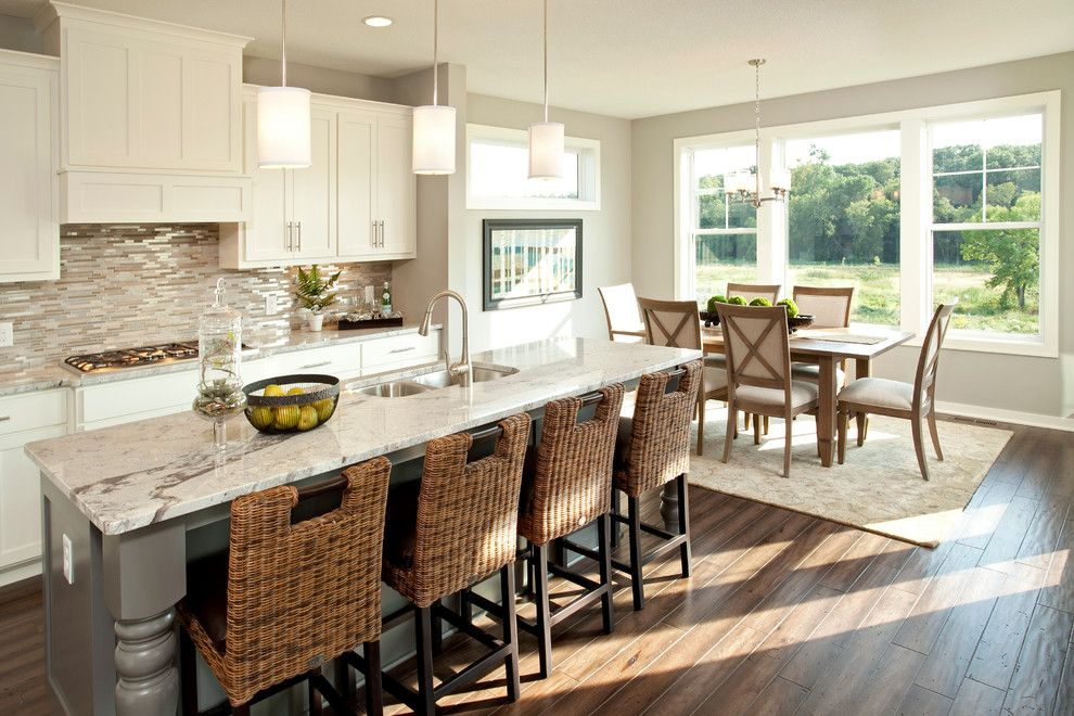 White Galaxy Granite for a Transitional Kitchen with a Sink in Center Island and the Broadmoor   Fall 2013 Parade of Homes Model by Robert Thomas Homes
