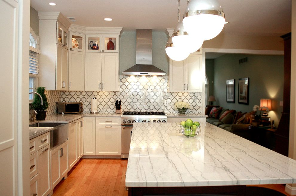 White Macaubas Quartzite for a Contemporary Kitchen with a Glass and White Macaubas Quartzite Kitchen by Stoneshop