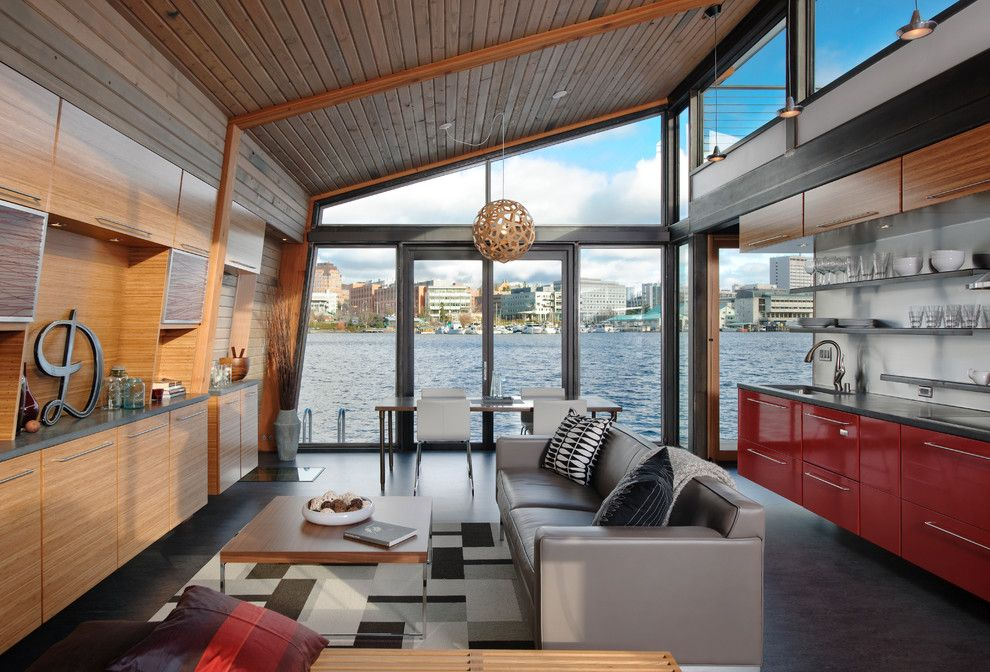 Whitehaus for a Industrial Living Room with a Clerestory Windows and Dyna   Portage Bay by Dyna Contracting