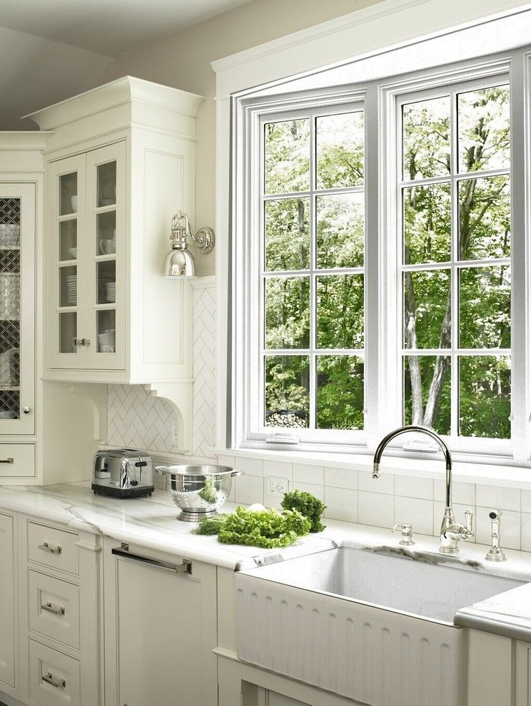Whitehaus for a Traditional Kitchen with a White Kitchen and Kitchens by Glickman Design Build