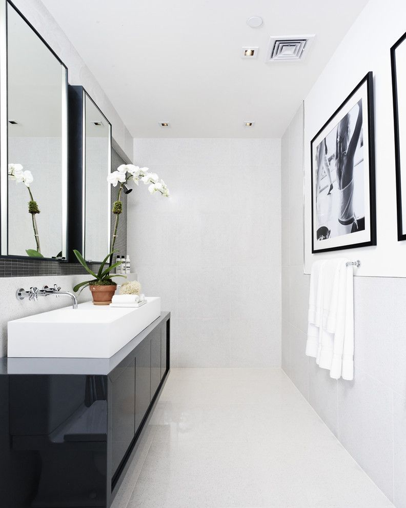 Whites Plumbing for a Contemporary Bathroom with a White Floor and Bathroom by D'apostrophe Design, Inc.