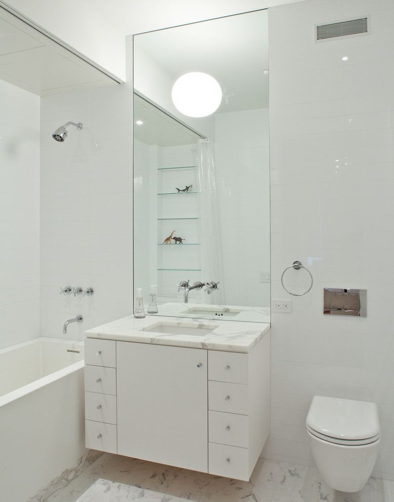 Whites Plumbing for a Modern Bathroom with a Wall Mounted Vanity and Modern Bathroom by wettling.com