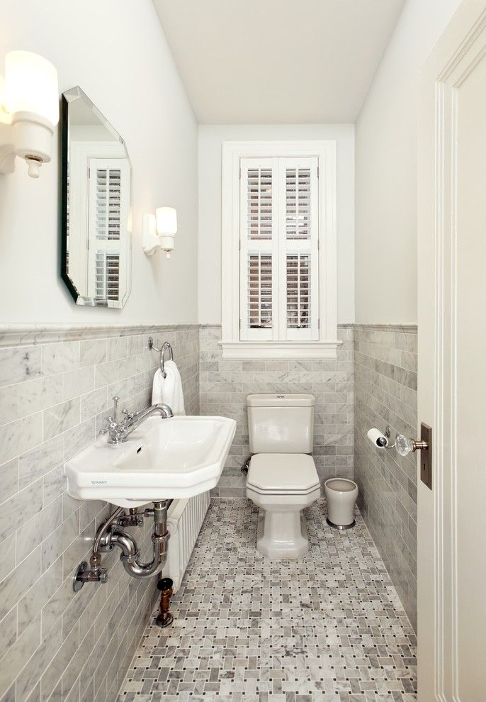 Whites Plumbing for a Victorian Powder Room with a Heater and Small Powder Bath by Four Brothers Llc