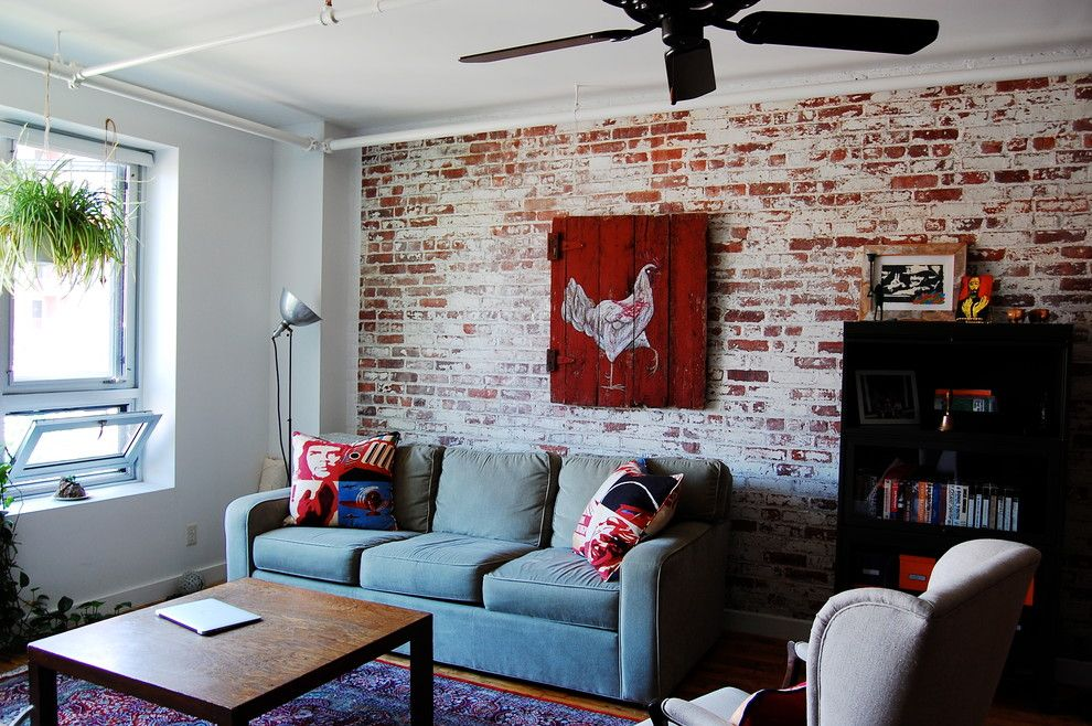 Whitewashing Brick for a Industrial Living Room with a Exposed Electrical Pipes and My Houzz: Textiles Charm an Open Brooklyn Loft by Corynne Pless