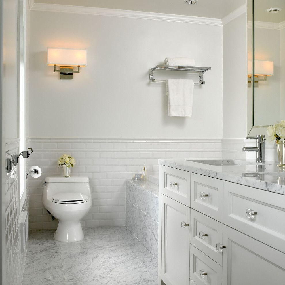 Whitfill Nursery for a Traditional Bathroom with a Soaking Tub and White Marble Bathroom by the Sky is the Limit Design
