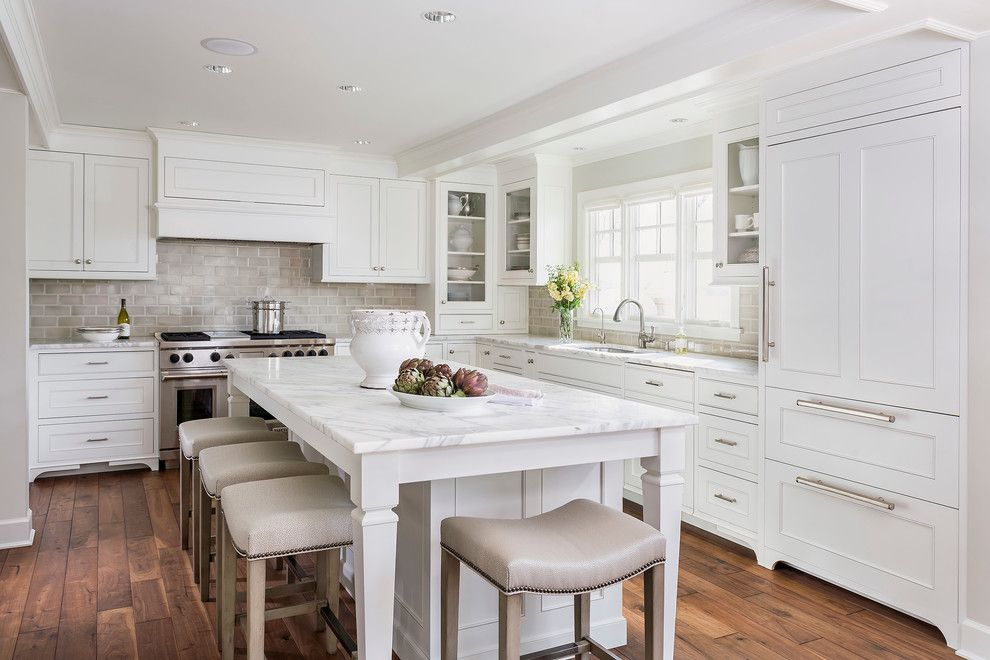Whitfill Nursery for a Traditional Kitchen with a Calcutta Marble and Lake Minnetonka Tailored White Kitchen by Liz Schupanitz Designs