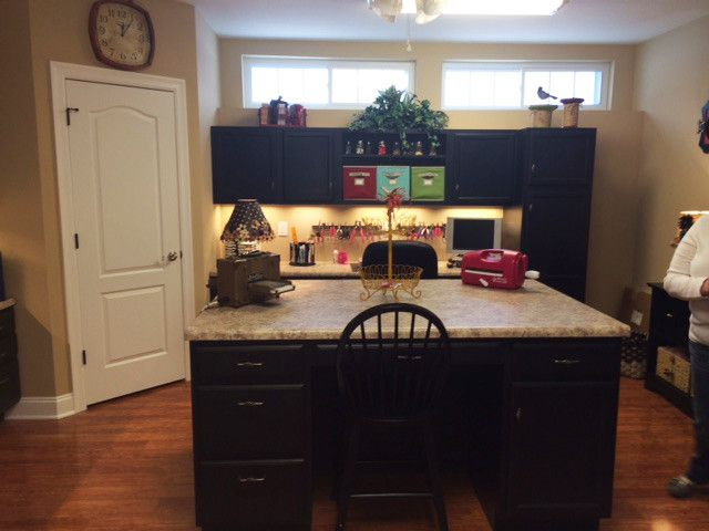 Wilke Window for a Contemporary Spaces with a Dark Cabinets and Mid Continent Cabinetry by Norm's Bargain Barn