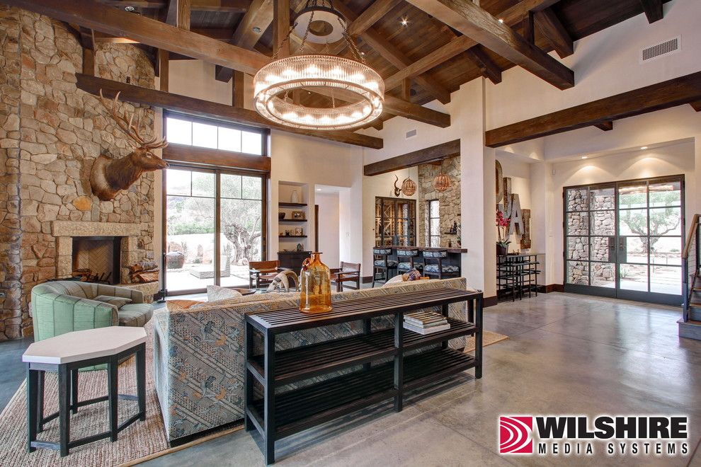 Wilshire Homes for a Farmhouse Living Room with a Home Automation and Lighting, Video & Audio: Ojai Farm by Wilshire Home Entertainment
