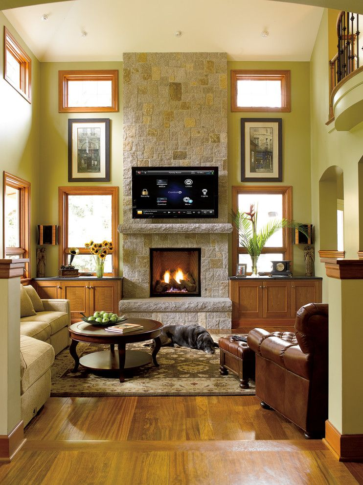 Wilson Parker Homes for a Craftsman Family Room with a Brick and Family Rooms by Magnolia Design Center