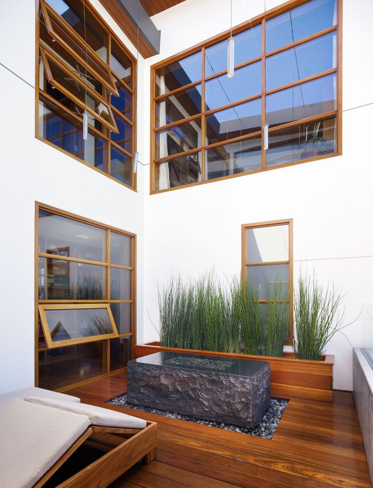 Wilson Parker Homes for a Tropical Patio with a Picture Window and Zen Garden by Rockefeller Partners Architects