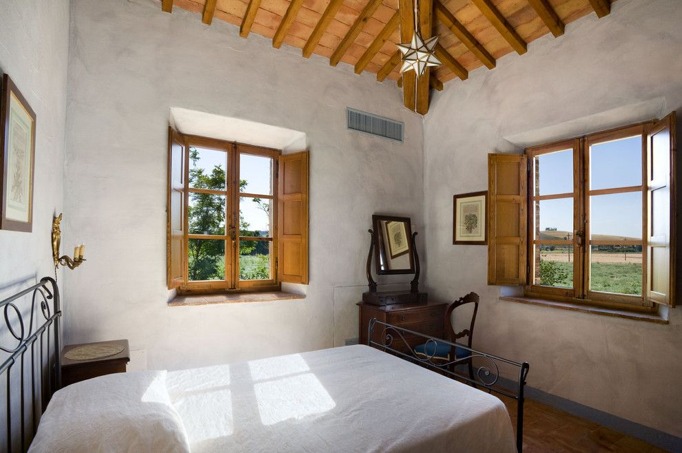 Window Sills for a Mediterranean Bedroom with a Sloped Ceilings and Tuscan Country House, Siena, Italy by Vanni Archive/architectural Photography