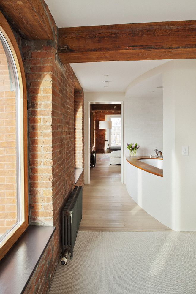 Window Sills for a Rustic Bathroom with a Loft and Hudson River Duplex Master Bath View by Mabbott Seidel Architecture