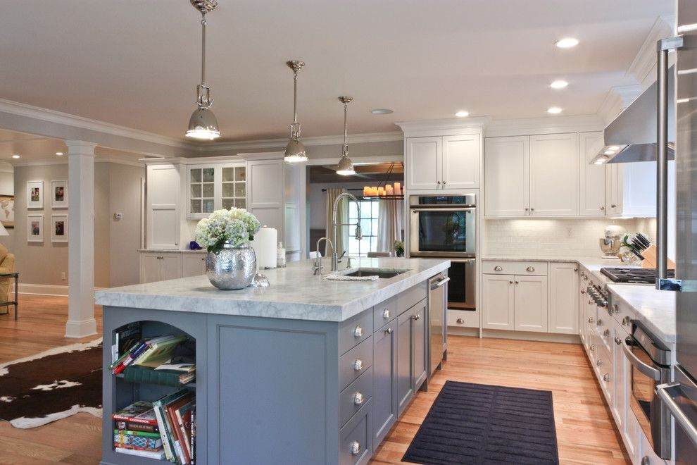 Wolf Classic Cabinets for a Traditional Kitchen with a Navy Blue and Classic Coastal Colonial Renovation   the Ultimate Island by Michael Robert Construction