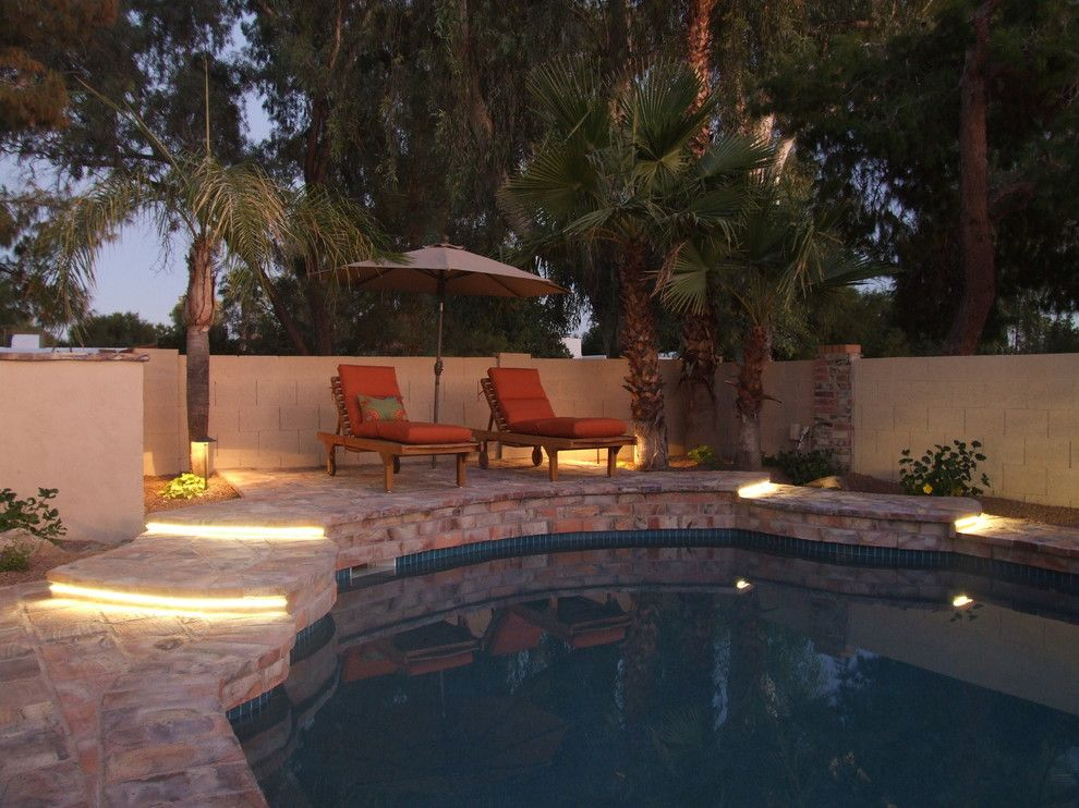 Wolfers Lighting for a Mediterranean Pool with a Outdoor Seating and Raised Deck with Led Ribbon Lighting at Steps. by Clemente Design Studio, Llc